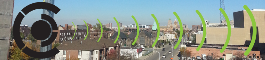 image of Detroit skyline with drawn wi-fi lines and a C for Cass Corridor